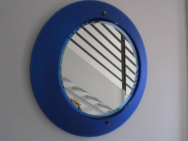 Rare Fontana Arte blue mirror. Convex blue mirrored frosted glass. Perfect original condition Bibl.: Specchi e Specchiere.