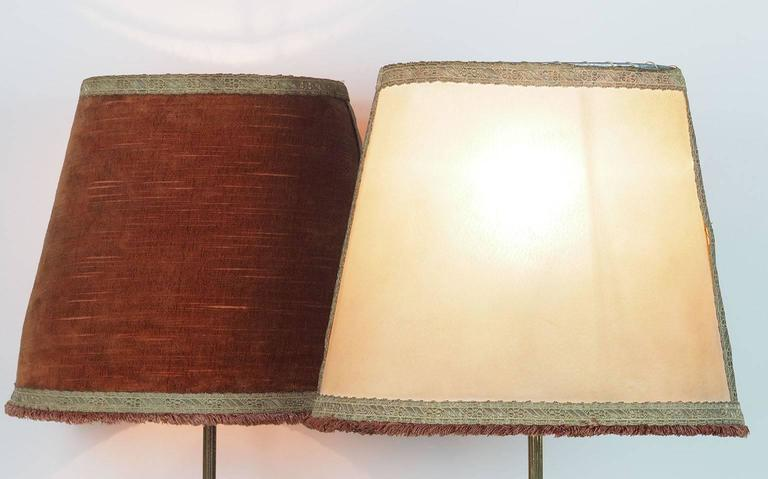 Large ( height 75 cm) couple of  brass table lamps with original Oval lampshades manufactured by Chiarini in 1950s. The original Bifronte parchment and velvet lampshade has a particular elliptical shape. They can be easily re done. The thinness of