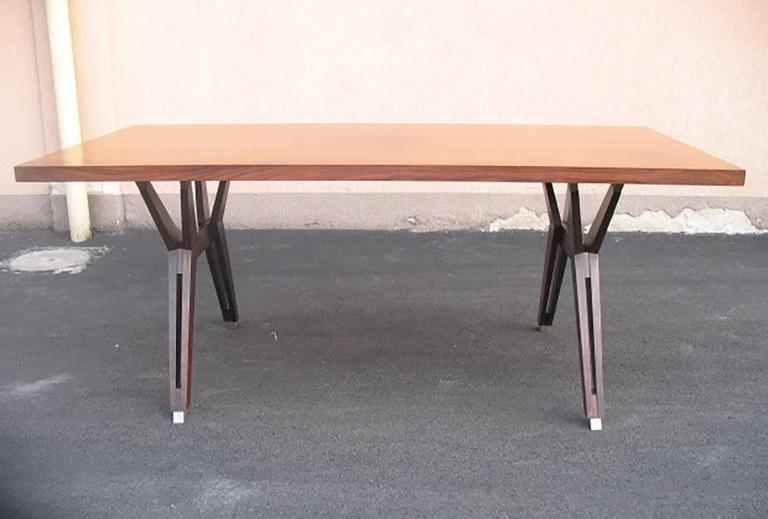 Beautiful table; iconic techinical design by Ico Parisi for MIM (Mobili Italiani Moderni) in Roma. Rosewood rectangular top on wood legs with final brushed steel sabot.
