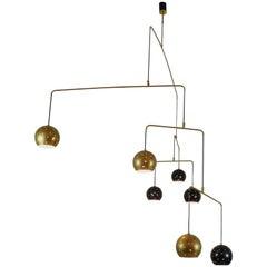 "Mobile Brass and black spheres Chandelier ""Magico e Meditativo""  Italy 1980s"