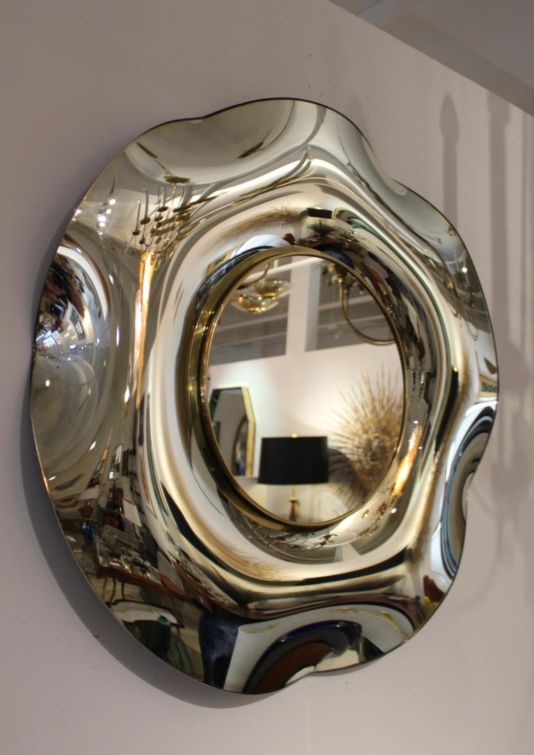 Stunning wave wall mirror by Ghiró studio, beautiful frame with brass detail.