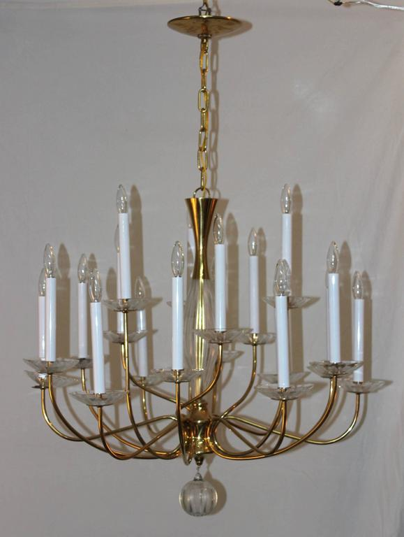1950s modern large brass and cut glass 18-arm chandelier by Lightolier.  The height can be adjusted.