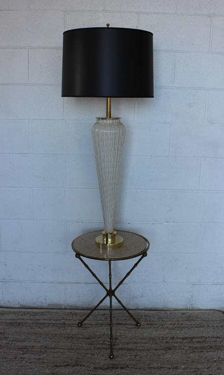 Stunning 1950s Murano glass table lamp, with brass hardware and newly rewired.   Shade for photography only.  Height to light socket 35''.