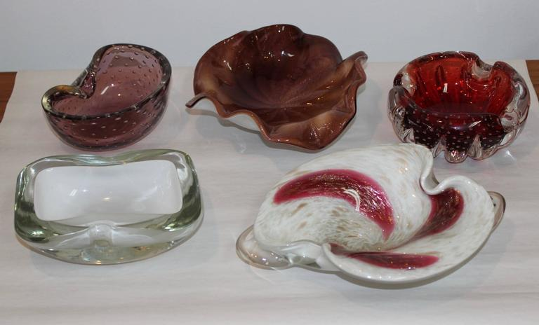 Mid-Century Modern Murano glass decorative glass bowls collection.  Price is per item please check the ones available below.  Dimensions:  Red bowl diameter 6'' height 2 25'' Sold White and clear width 7'' depth 5'' height 2.25'' light purple width