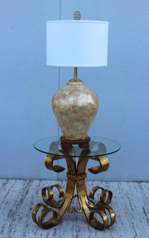 Large 1970s Capiz shell table lamp, with teak base and brass hardware.  Shade for photography only.  Measure: Height to light socket 24''.
