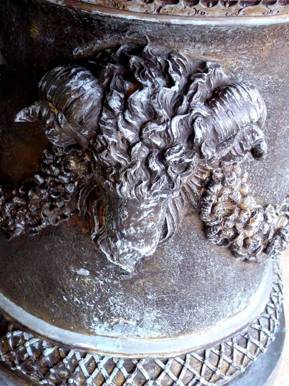 A monumental bronze garden urn, planter, or jardiniere, decorated with three large and four small ram's heads, garlands, leaves, egg-and-dart molding, and other adornments. Complete with rarely seen lid. Magnificent!  A few important notes about all