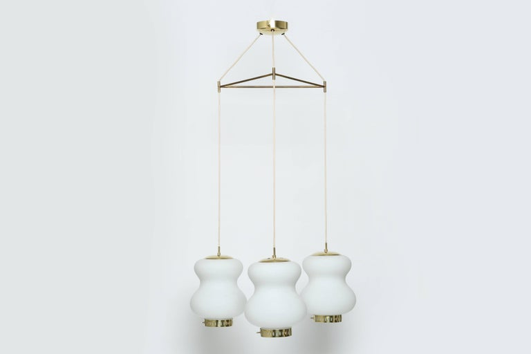 Stilnovo ceiling pendant with three lights.