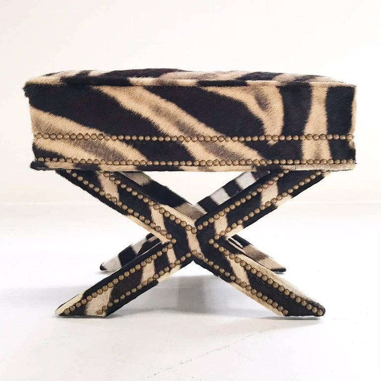 Stunning Billy Baldwin style X bench destined for an amazing room. This is glitter and gold and glamour! The work and craftsmanship to bring this bench back to life is incredible. The luxurious zebra hide is meticulously wrapped around each X shaped