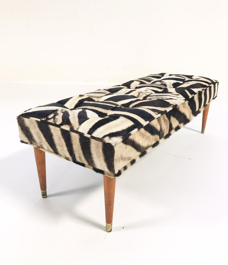 We keep picturing this gorgeous one-of-a-kind bench at the end of a beautiful bed or down a handsome hallway. Our designers chose to do a patchwork zebra hide as an extra design detail, complementing the simple wood and brass straight