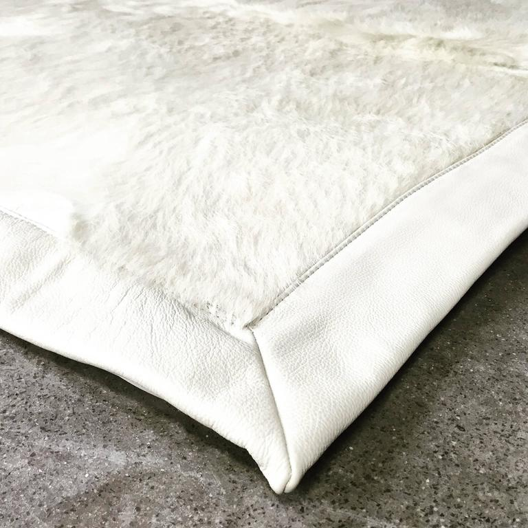 The Forsyth design team examined hundreds of rare ivory cowhides to perfectly match four beautiful hides for this amazing one of a kind rug. The natural ivory hides create a truly breathtaking work of modern art.   Each hide is hand-cut and