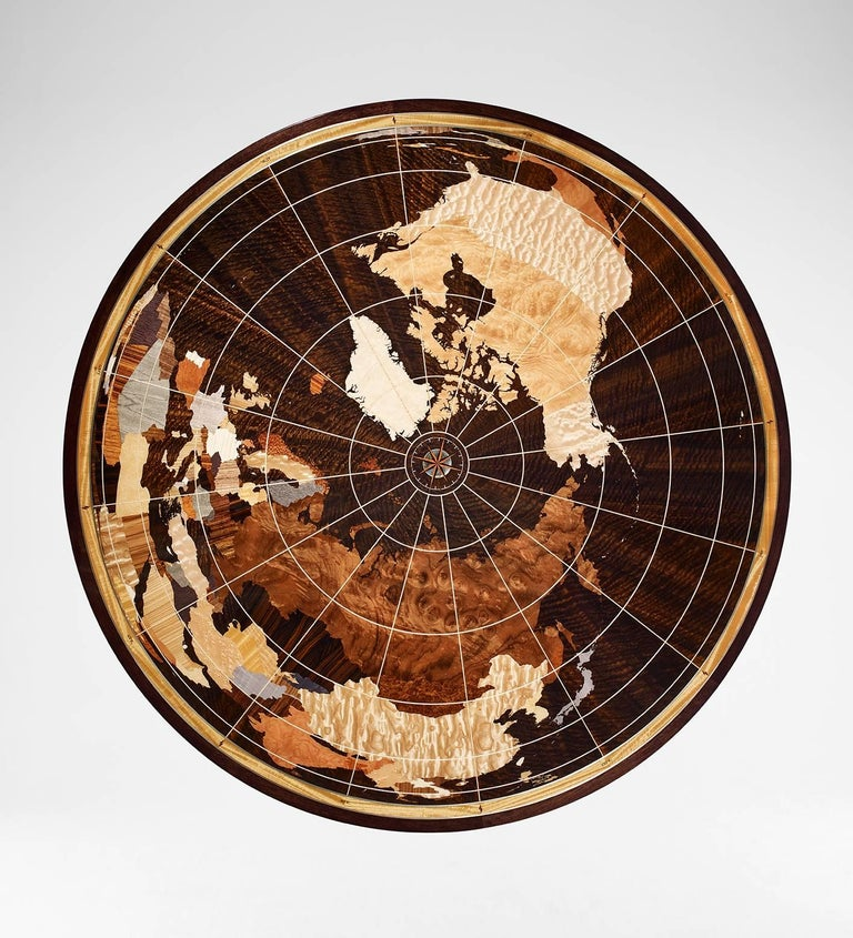 The unique Linley World Map table is hand-crafted by our specialist craftsmen in the UK using over 40 individually selected veneers. The main body of the table is created out of stained Fulbeck walnut in a high gloss finish. The base features