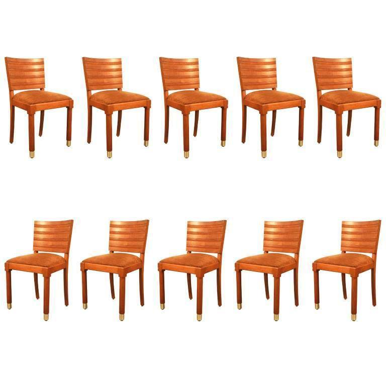 Gaston Poisson, Set of Ten Art Deco Chairs in Oak and Brass For Sale