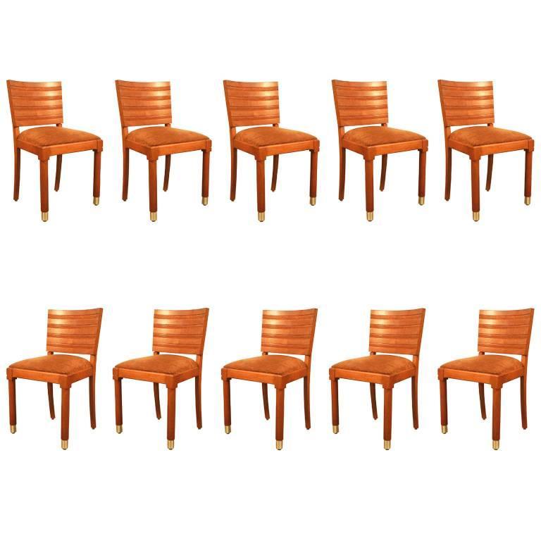 Gaston Poisson, Set of Ten Art Deco Chairs in Oak and Brass