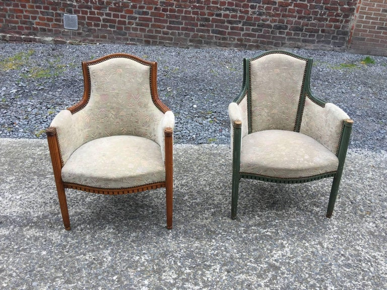 two  elegant Art Deco armchairs, circa 1925-1930 Same model but one with green patina and the other in natural wood.