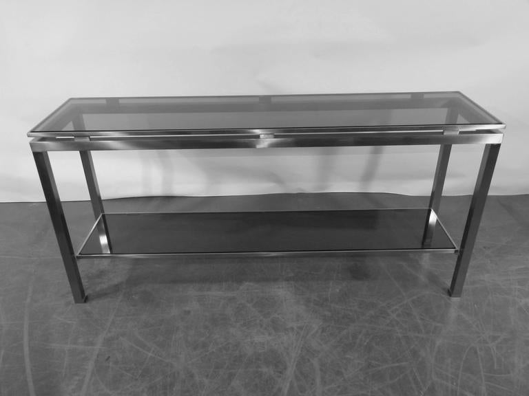 Guy Lefevre large console in brushed steel, with tinted glass, Maison Jansen.