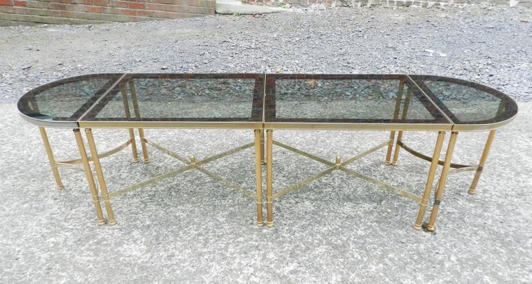 Maison Baguès, 1950 adjustable coffee table in brass, tinted glass and mirror.