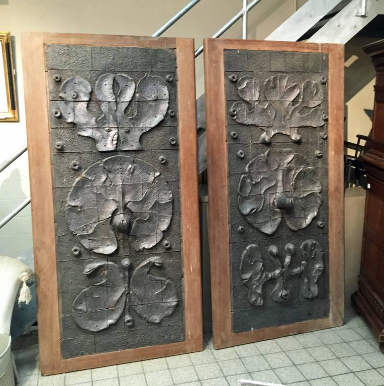 Yves Rhayé(1936-1995), exceptional sliding doors with ceramic design, circa 1970.  Back and frame in solid oak. Back with Louis XV style molding panel.  Measures: 202 x 102 cm each These doors were created for a house in Bruxelles. A few