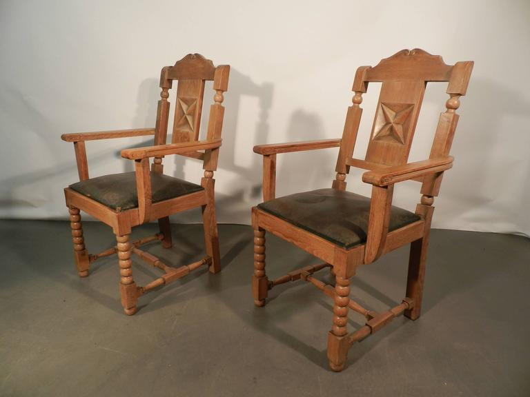 In the style of Charles Dudouyt, pair of neo rustique oak armchairs.