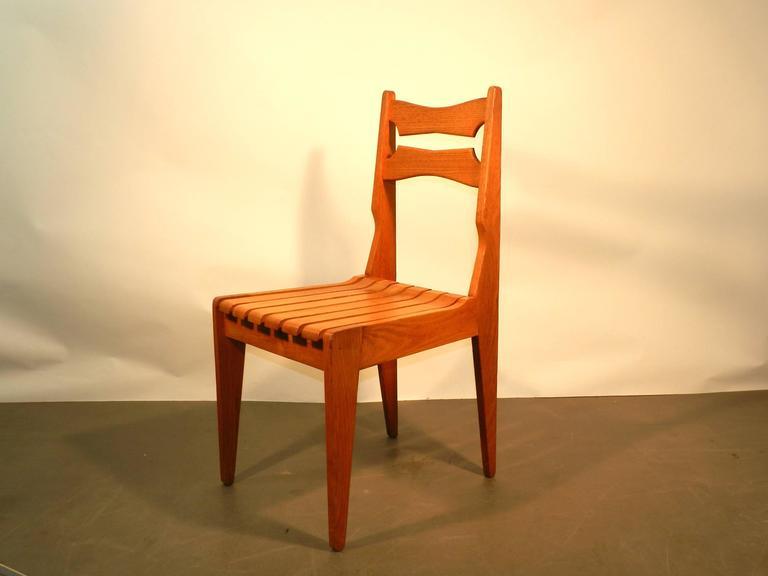 Set of Six oak chairs by Guillerme et Chambron for Votre Maison, circa 1960.