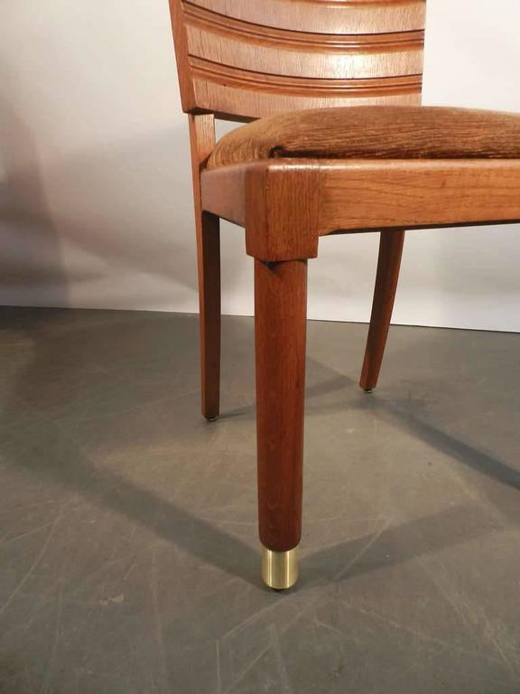 French Gaston Poisson, Set of Ten Art Deco Chairs in Oak and Brass For Sale