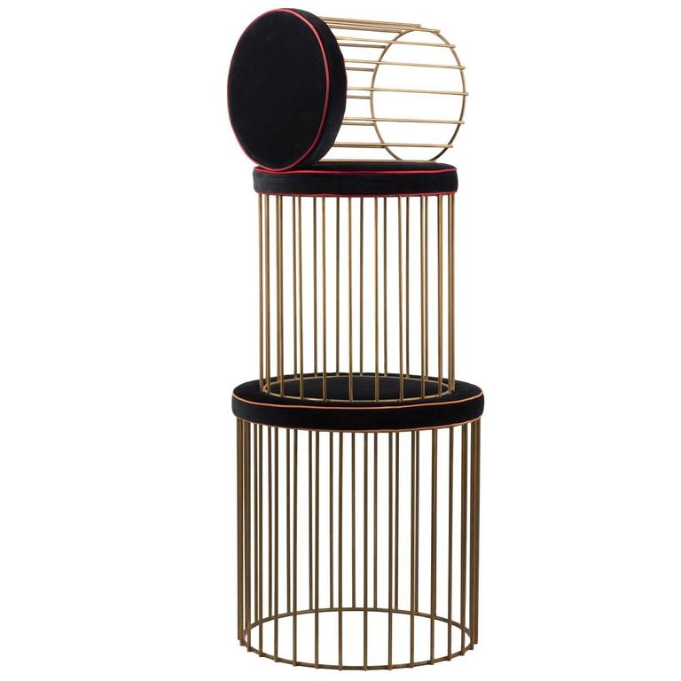 This set of three cushioned seats comes complete with a small, medium and large size. The soft cushions are supported by a delicate caged construction in a cylindrical shape, cast in natural brass and finished beautifully. The seats come with black
