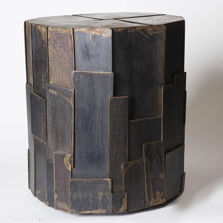 Sculptural side table in treated iron sheet by Sciortino. The metalwork is painted black, with a rough finish that lends the work an air of Industrial. Measurements and finish may vary slightly due to the artistic nature of Sciortino's production.