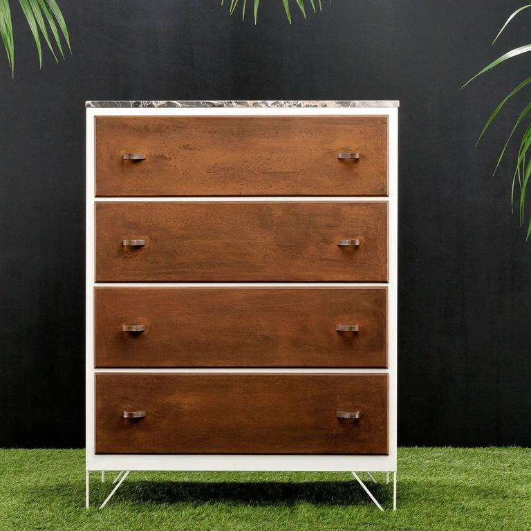 This piece is a contemporary reinterpretation of a grandmother's dresser. The marble top and retro flavor create an antique elegant allure. The steel finish or the structure strikingly contrast with the surface of the marble and the texture of the