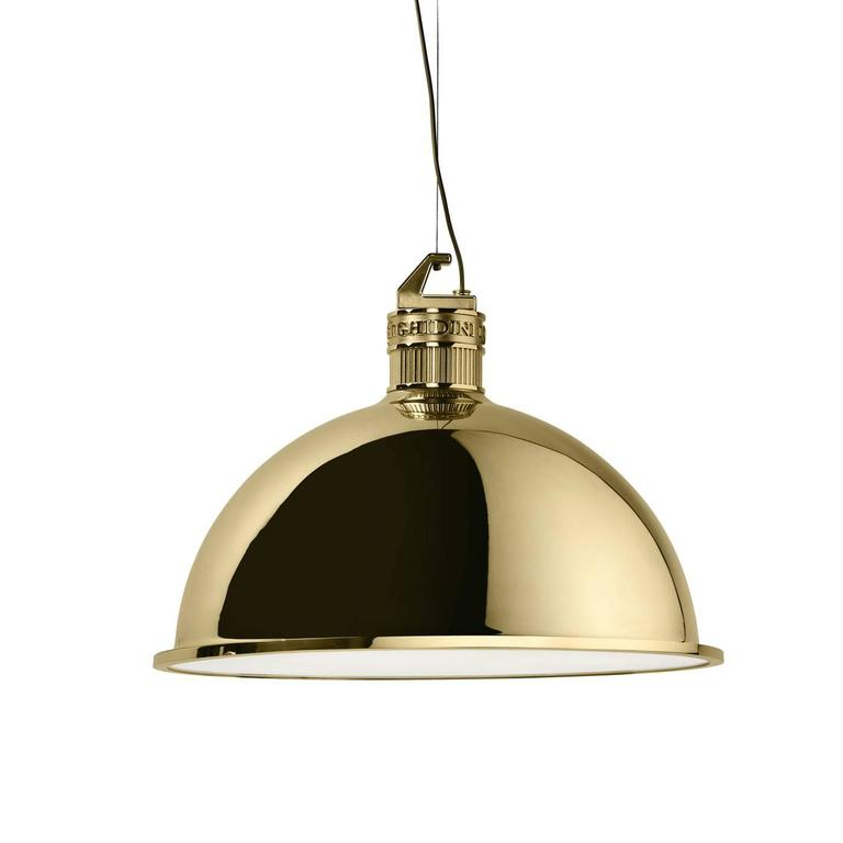 Elisa Giovannoni designed this pendant light (also available in a smaller version), inspired by the Industrial lamp, a design icon that here has been revisited with a contemporary sensibility and made in brass.