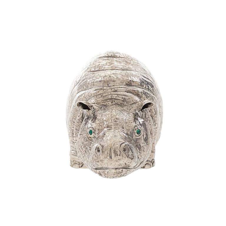 This is a playful true-to-life silver hippopotamus that serves as a lighter other than being a decorative piece of artwork. Expertly handmade by the Florentine silversmiths, the Lisi Brothers, its realism and expressive quality are quite uncanny.