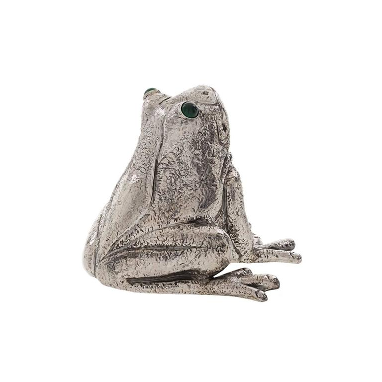 Playful true to life silver frog that serves as a lighter other than being a decorative piece of artwork. Expertly handmade by the Florentine silversmiths, the Lisi Brothers, its realism and expressive quality are quite uncanny.