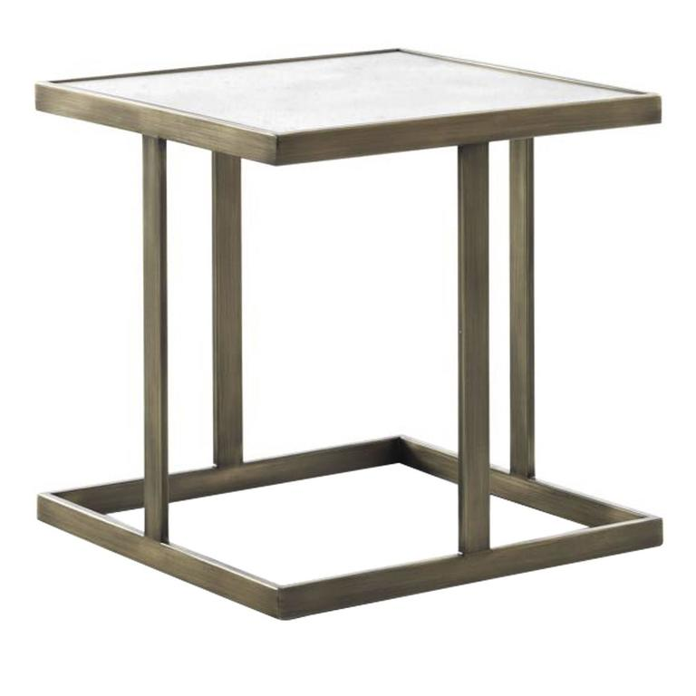 This exquisite coffee table is part of the Astor series, featuring small tables of different sizes, heights, and shapes. In this case the square structure is in metal with a streaked brass finish and its clean lines support a top in luxurious gold