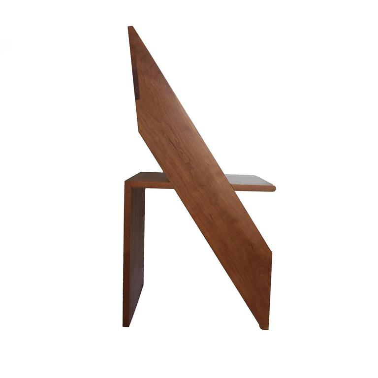 This magnificent re-interpretation of an everyday life object is a perfect addition to a contemporary or modern decor, thanks to its Minimalist lines and its two crossing elements that create respectively seat and back leg, and front legs and
