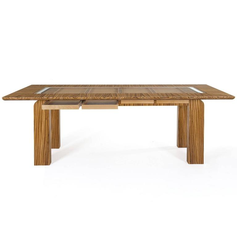 This table features a Minimalist silhouette that will make an elegant addition to any decor whether classic or contemporary. Its rectangular top, perimeter edge, and legs are all crafted entirely in zebrawood with accents in smoked maple wood and