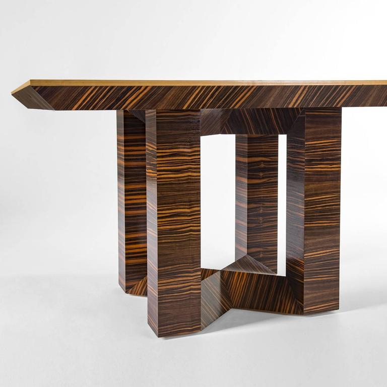This square table features a unique look that will make a statement when placed in any home. The structure of the tabletop was crafted in ebony Macassar wood, which has been worked using a interwoven technique creating alternating grain patterns.