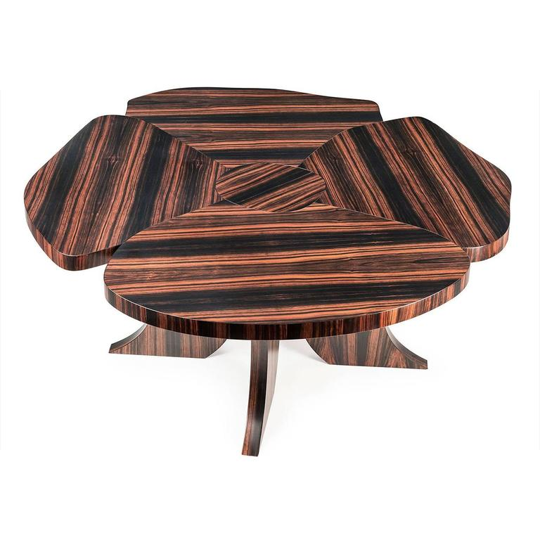 Part of the Andy collection, this table is made entirely in precious ebony wood with a lacquered finish that enhances the natural veins of the wood. The curved four legs and the top, in the shape of an opened flower, are staples of the Andy series