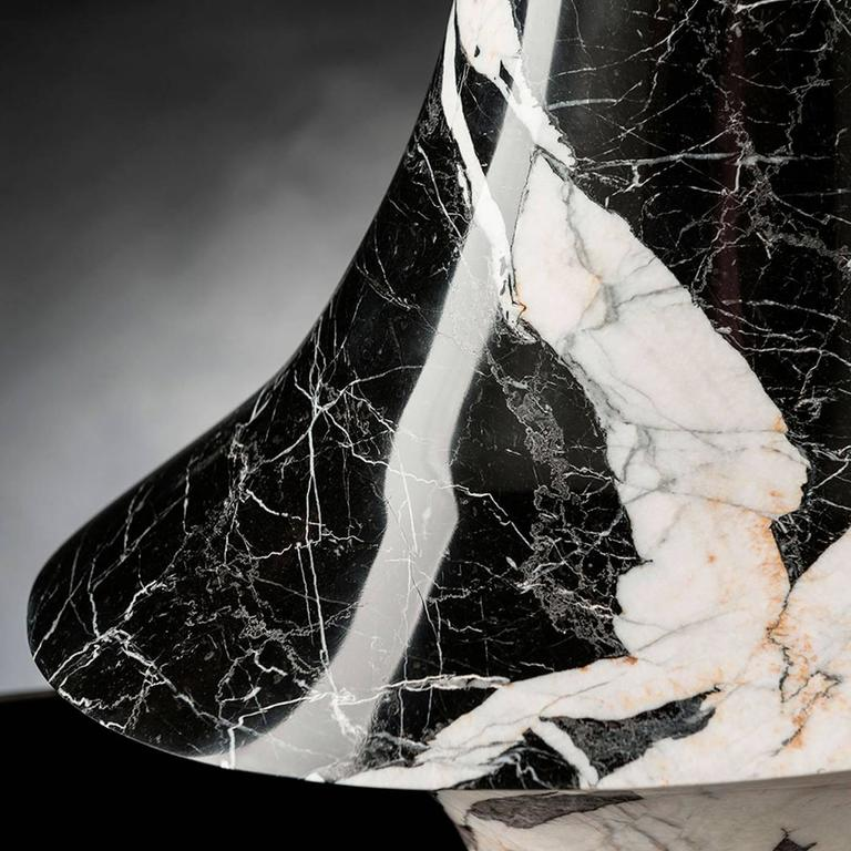 This magnificent small decorative vase is entirely made in Grand Antique marble, a precious variety of black and white French marble made by processing natural stones with five-axis pantographs. This technique makes it possible to achieve complex