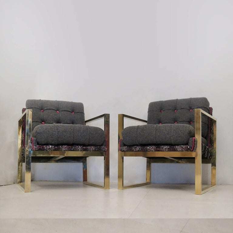 This exemplary set of armchairs will make the perfect addition to any home when placed in a contemporary room. The geometric brass structure strikingly contrasts with the soft curves of the comfortable cushions. The bases of seat and backrest in