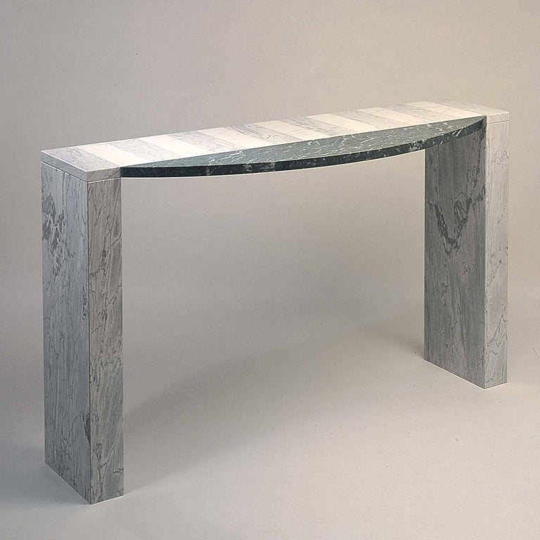 Behind the simple and clear-cut line of this captivating console designed by Eric Gottein lies a combination of impeccable construction and craftsmanship that place lightness at the heart of the design. Combining the highest quality natural stones,