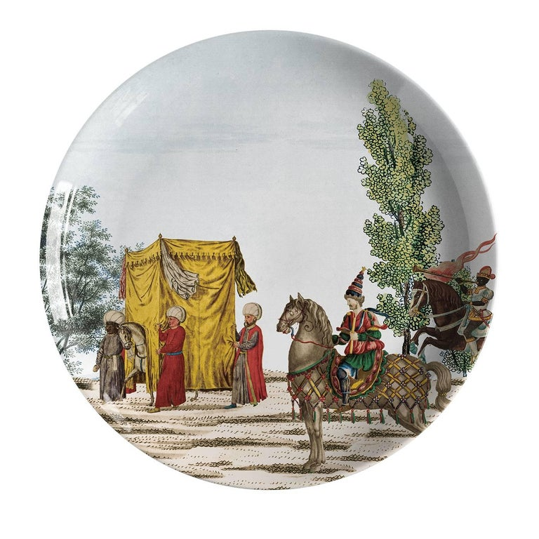 These exquisite porcelain plates are part of a collection of 12 pieces that portrays the triumphant entrance of the Sultan in the city. Bringing to life an imaginary event through a vivid representation of the celebrations and characters of the