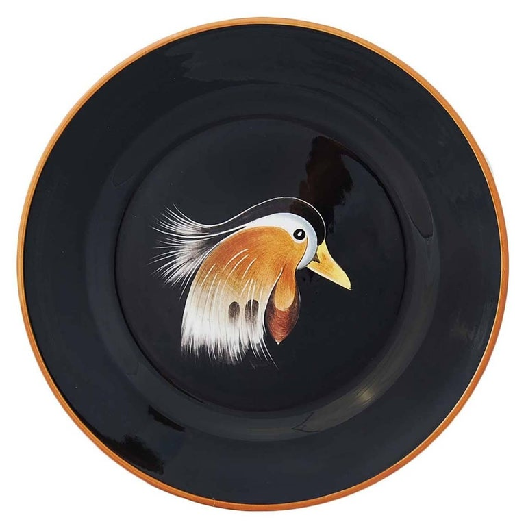 Set of six dinner plates in jet black, entirely handcrafted and hand-painted by the skilled artisans of Este Ceramiche. Each piece comes with a different depiction of a wild duck, making every plate a true one of a kind.