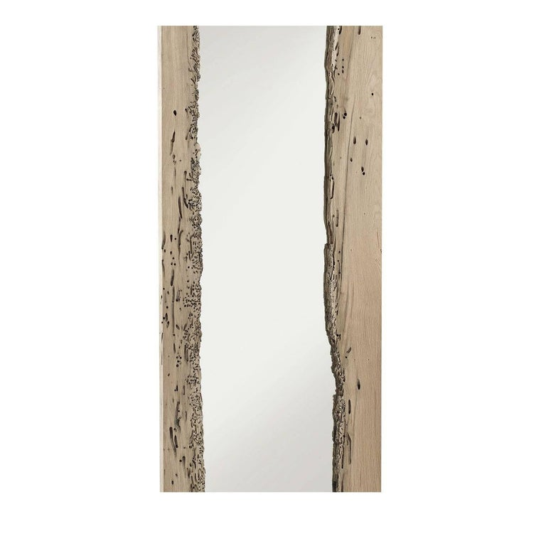 This exquisite wall mirror visually recreates the atmosphere of Venetian canals, paying a tribute to this unique city. This piece incorporates two boards of wood that retains its original texture and form, with a mirror inserted in between. The