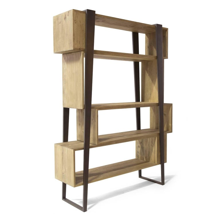 This sophisticated bookcase has a very particular look to it and will give any décor a unique and modern accent. Solid pieces of antique spruce wood were used to craft the intriguing forms of the rectangular shelves, each one in a similar yet