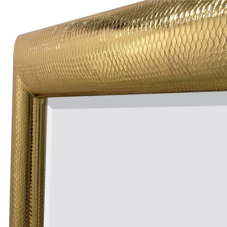 This mirror boasts a genuine python leather upholster over the wooden frame that was covered in striking gold. The effect is a unique piece of functional decor that will be a perfect complement to a colorful contemporary interior. The luminous