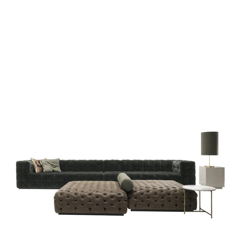 The long even frame of this classic sofa is made of spruce and poplar wood and features sleek arms and back frame of equals heights. Upholstered entirely in a stunning green-black fabric in a tufted settee pattern. Expanded polyurethane lines the