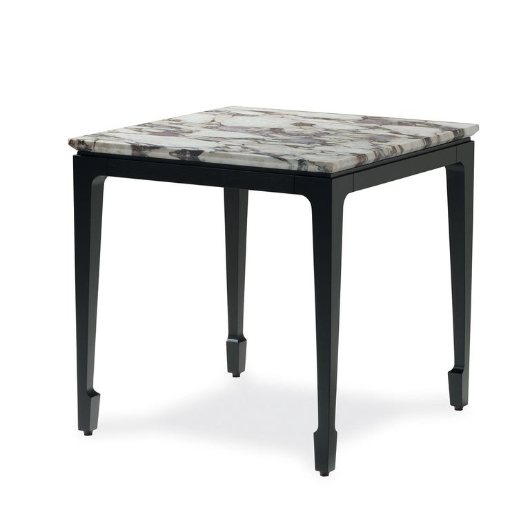 This stunning side table will be a versatile addition to a modern home. Its geometric structure is made of durmast with a delicate sculptural decoration at the bottom of each of the four legs. The top is in marble, whose natural veins will add a