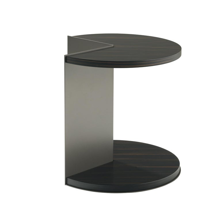 Striking and unique, the playful design of this side table is also its very functional aspect, which allows it to come close to a bed, sofa or armchair becoming a perfect companion for relaxing times spent reading a book or lounging with a drink.
