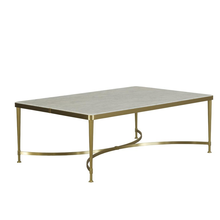 This sophisticated coffee table boasts a timeless color combination, elegant design, and high quality materials for a look that will enrich both a contemporary and a traditional setting. The rectangular marble top, with a polyester varnish is