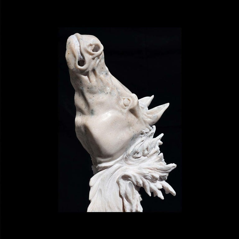 Entirely handmade using ancient techniques, this marble sculpture of a horse is a magnificent piece of art that will boldly shape the character of any room. Drawing from mythological themes, the horse's contorted snout in pink marble and wispy hair