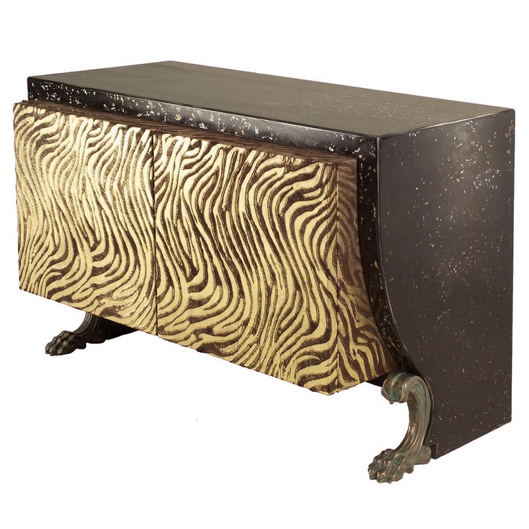 Part of the Etruska collection of eclectic pieces that mix modern flair with classical inspirations, this sideboard is playful and elegant. Its wooden structure is supported by four clawfoot feet in bronze. The frame of top and back is in the unique