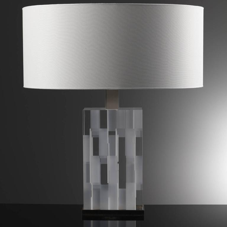 The body of this exquisite lamp is made of a complex structure of squared and rectangular Lucite pieces in brown and transparent finishes. The effect is a single block that changes color and design depending on the point of view. The top and bottom
